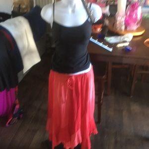 Pink color lock skirt with asymmetrical hem.